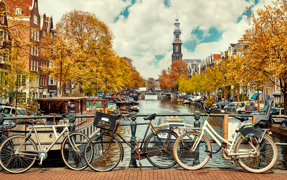 Bicycles over Amsterdam's canal Family Spring Break Destinations