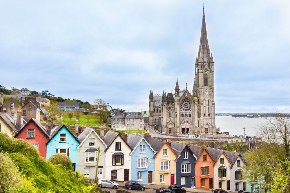 Cathedral and colored houses in Cobh, Ireland Ireland Travel Guide